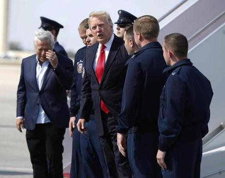 Patriots owner Robert Kraft (far left) was spotted with President Donald Trump before boarding Air Force One in Florida on Sunday.